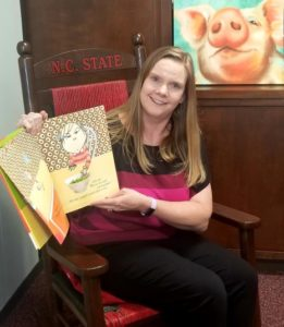 Family and Consumer Sciences agent Regina Moseley with a story book