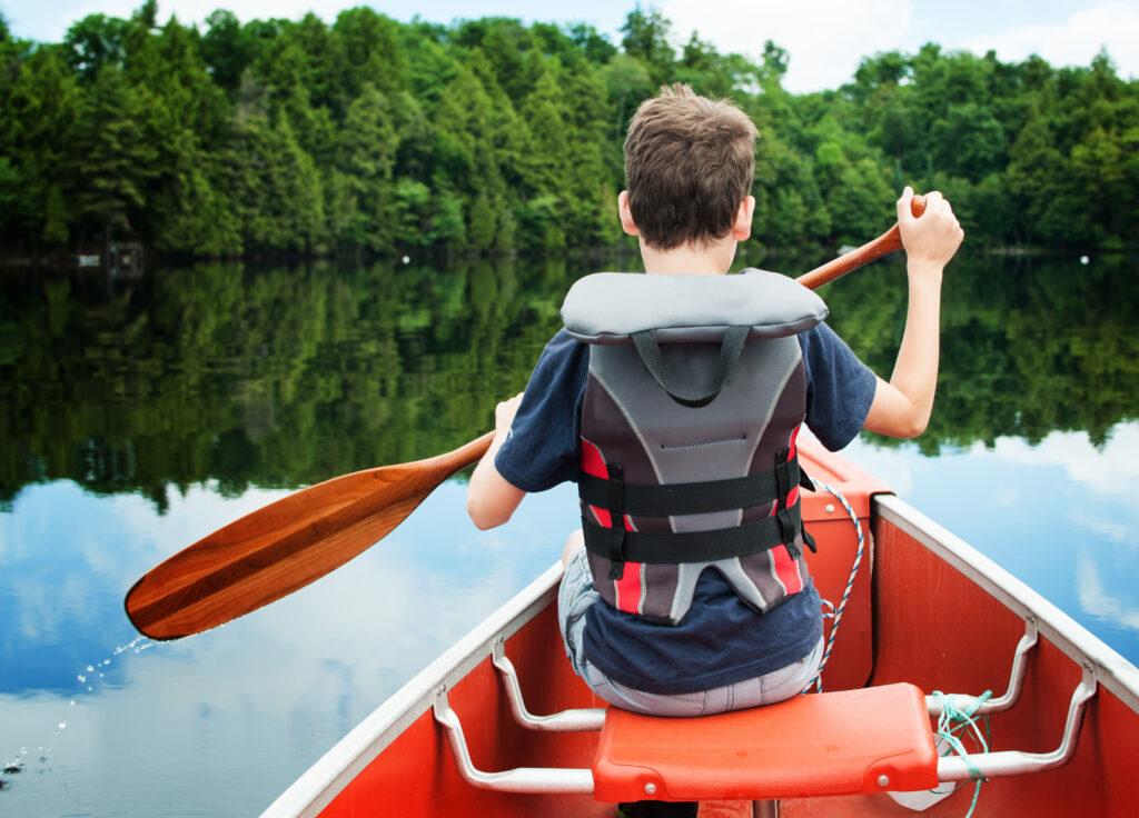 Boy in canoe