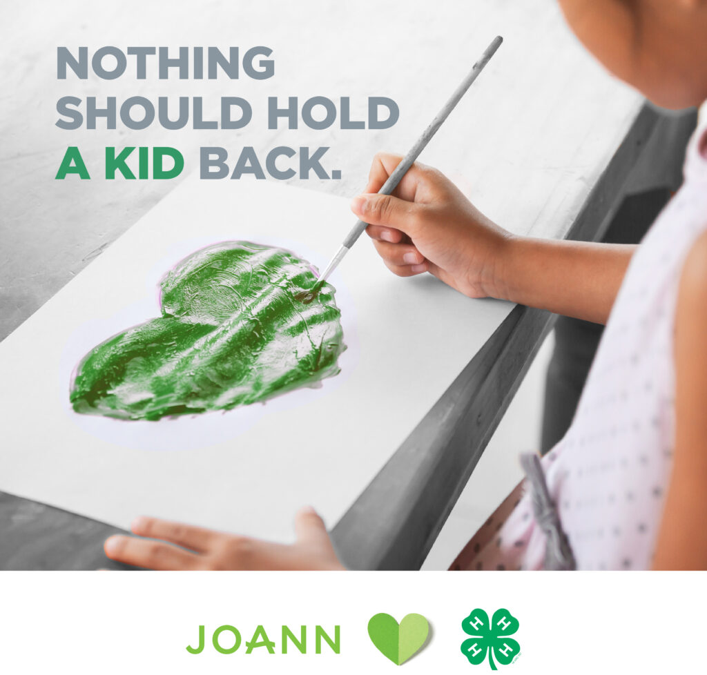 Child painting a green heart