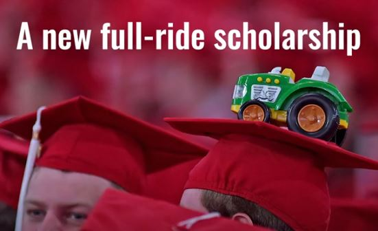Toy tractor on a graduate cap